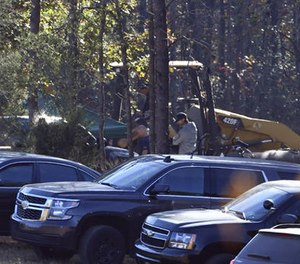 Excavation and search work continues on Todd Kohlhepp's property in Woodruff, S.C. Monday, Nov. 7, 2016. (AP Photo/Richard Shiro)