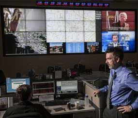 """In this photo taken Friday, June 29, 2012, Jeff Brantingham, anthropology professor at the University of California Los Angeles, displays a computer generated """"predictive policing,"""" zones at the Los Angeles Police Department  Unified Command Post (UCP) in Los Angeles. (AP Photo/Damian Dovarganes)"""