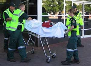 ACTAS Paramedics transport a mock-victim during a mass casualty exercise in Canberra. (Chris Wagner)