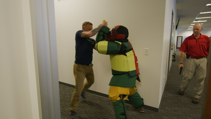 A participant practices defense moves against instructor Griffin. (Photo/Safariland)