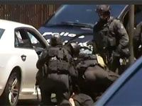 Riot police take down suspected bomber