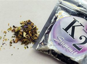 This Feb. 15, 2010, file photo shows a package of K2, a concoction of dried herbs sprayed with a synthetic compound chemically similar to THC, the main ingredient in marijuana. (AP Photo/Kelley McCall, File)