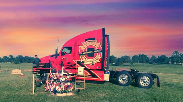 The Memorial Run truck sits by the gravesite of Tyler Casey. (Photo/Randall Rogers)
