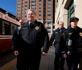 This photo shows University of Maryland Police Chief David Mitchell, second from left, and UMPD Police Officers, from left, Mike Weller, Robert Jenshoej, and Sgt. Rosanne Hoaas, walking on a sidewalk at the extended jurisdiction area of the University of Maryland in College Park. (AP Image)