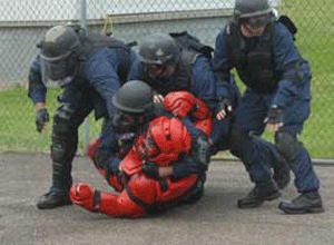 """Mock Prison Riot, May, 2009. """"Failure is not an option."""" (Pat Weyand photo)"""