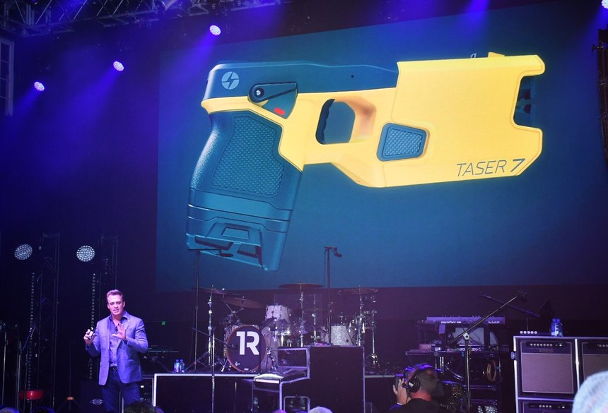 Rick Smith introduces the TASER 7 at the House of Blues in Orlando during IACP 2018. (Photo/PoliceOne)