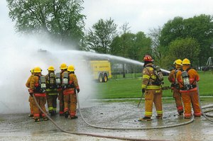 A Denmark Fire & Rescue crew works to put out a fire.