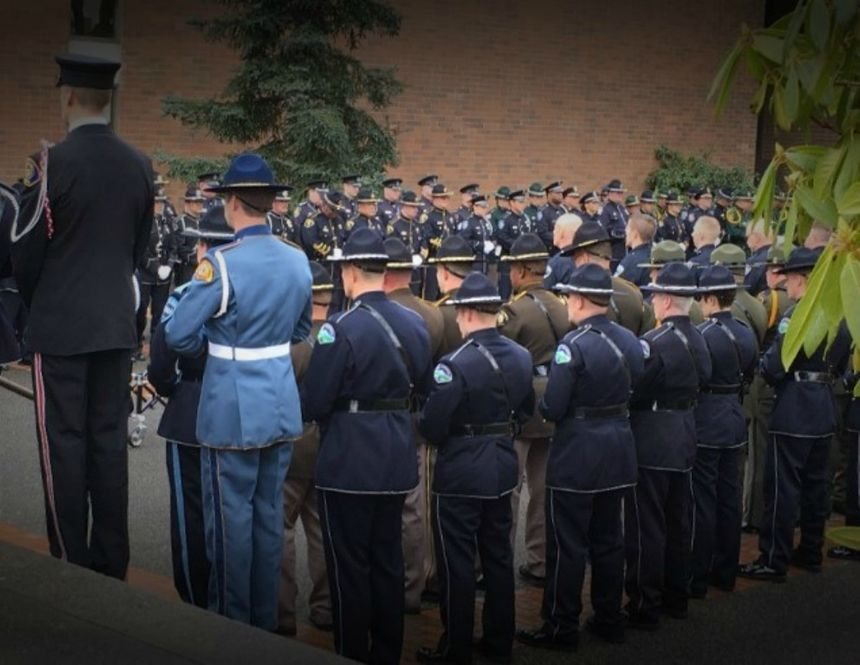 Being part of a memorial serviceis a sacred and heavy burden to bear for those who wear the Honor Guard uniforms. (Photo/Linda Robson)