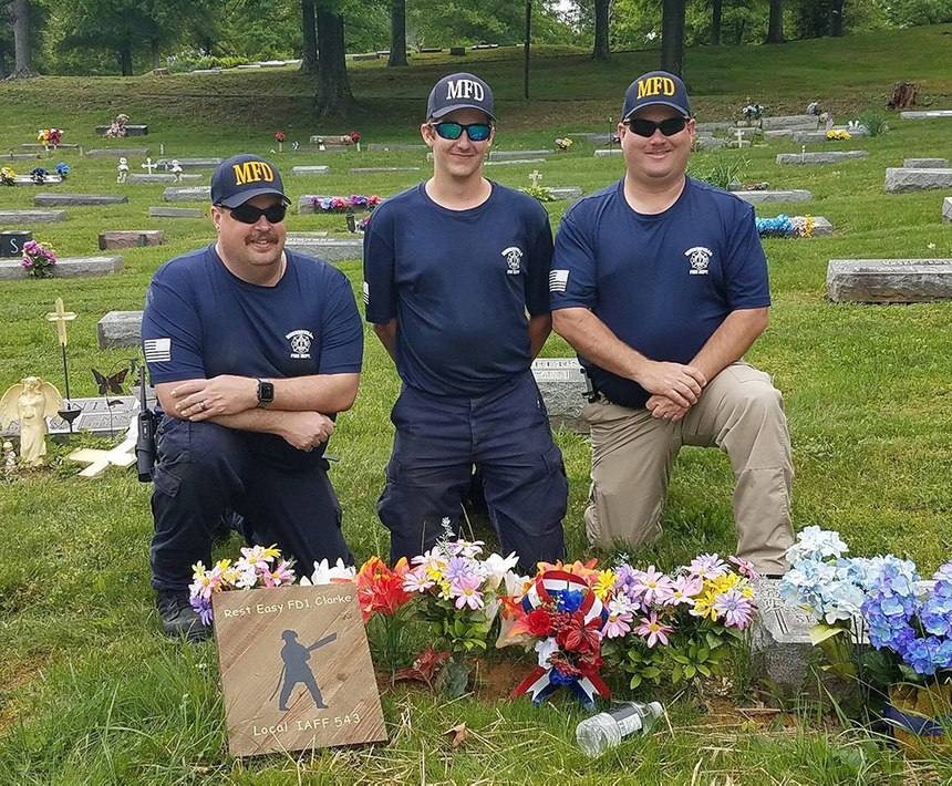 Assistant Chief Kevin Kimple, firefighter Brady Clarke (Noel's son), Chief Gary Brandon at Chief Clarke's grave
