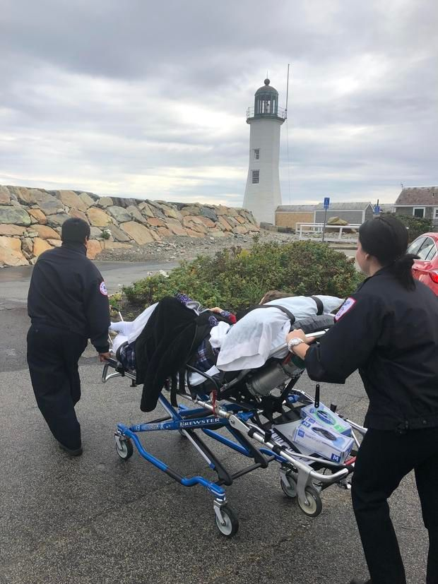 Laura Mullins is wheeled to the Scituate Lighthouse. (Photo/BAS)