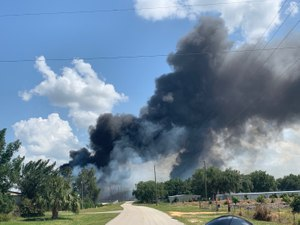 Propane plant burning to the left, trailers burning to the right. (Photo/Marc Bashoor)