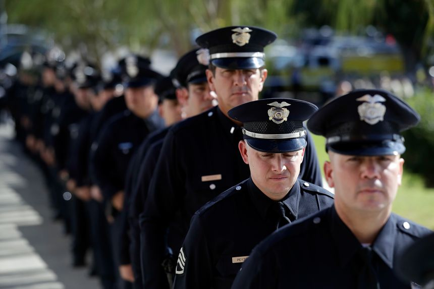 Law enforcement personnel wait to enter the Calvary Community Church for a service in memory of Ventura County Sheriff's Sgt. Ron Helus at Thursday, Nov. 15, 2018. (AP Photo/Marcio Jose Sanchez, Pool)