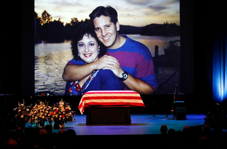 A family photo during a video montage of Ventura County Sheriff Sgt. Ron Helus with his wife Karen years ago.  (Al Seib /Los Angeles Times via AP, Pool)