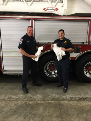 Firefighter/Paramedic Sean Kilgannon and Lt. Rob Neuberger receiving their GORE® Particulate Hoods