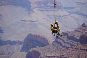 A short-hauler and simulated patient are extracted from a slope below the rim. (Photo/Courtesy of the National Park Service)