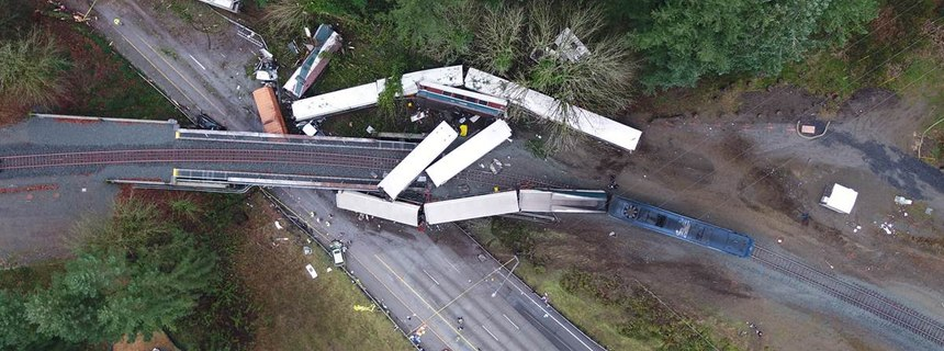 The as-found scene of the Dupont train incident where 11 of 14 rail cars of an Amtrak derailed, killing three people and injuring 62 passengers and 6 crew members. (Photo/WSP)