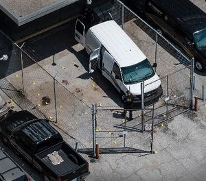 Evidence markers dot the pavement just outside the Wyandotte County courthouse, Friday, June 16, 2018, in Kansas City, Kan. (Photo/The Kansas City Star via AP)