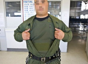 An officer displays a newly re-issued stab and ballistic vest. These vests are worn by all of the officers at the R.J. Donovan Correctional Facility. (Angela Carone/KPBS)