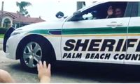 Baby waves to Fla. cop dad