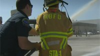 Boy, 7, reunited with firefighters who saved his life