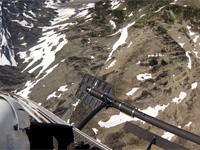 Flight medic cameras show mountain side rescue and hoist