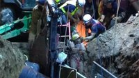 Firefighters free construction worker buried in trench