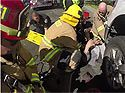 Calif. firefighters rescue cyclist trapped under truck