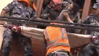Responders rescue man from collapsed building in Nepal