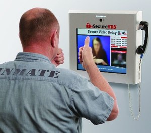 An inmate using secured video relay. (Image/Tidal Wave Telecom)