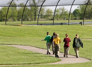 Unidentified youthful offenders at Scioto Juvenile Correctional Facility walk around the track during recreation time Tuesday, May 12, 2009, in Columbus, Ohio. (AP Photo/Jay LaPrete)