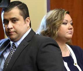 In this June 24, 2013 file photo, George Zimmerman, left, arrives in Seminole circuit court, with his wife Shellie, in Sanford, Fla. (AP Image)